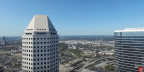 Drone takes up up and away dizzying look of Downtown Houston